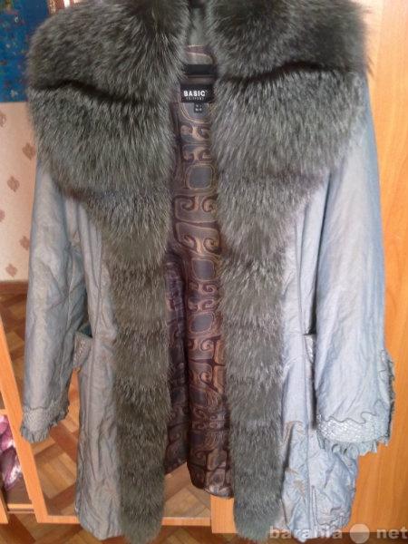 Продам зимнее пальто новое