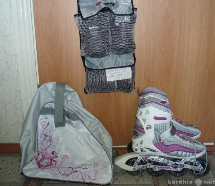Продам Роликовые коньки с сумкой и защитой