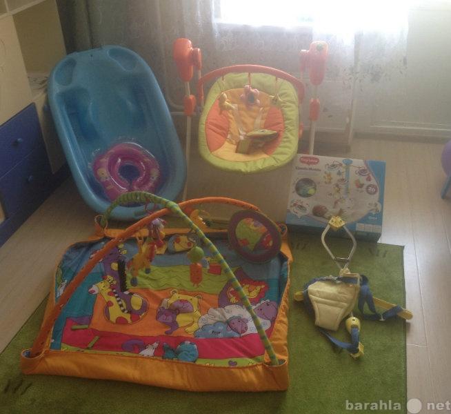Продам Электроное кресло-качалка, ванночка и др