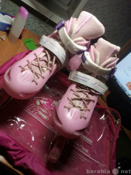 Продам: роликовые коньки(розовые)