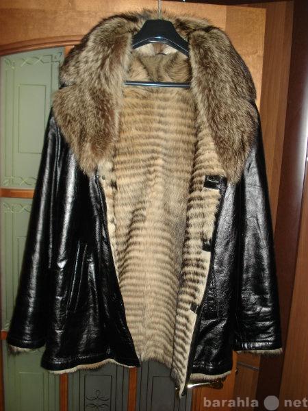 Продам куртка кожаная с мехом волка.