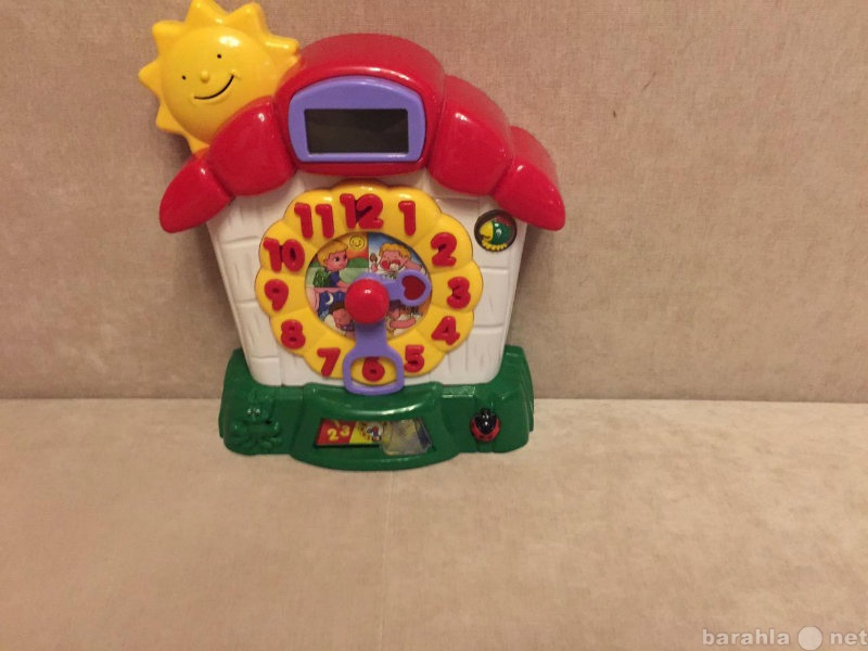 Продам игрушку развивающую часики знаний